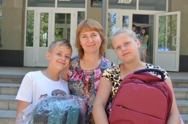 Polina* and her brother Kirill* fled Luhansk oblast last year. They came with their mother and grandmother to pick up their backpacks for the new school year. Photo Elena Kushch/Save the Children
