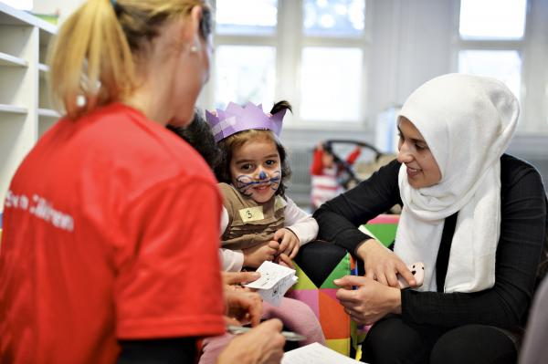 Mada's* birthday at the opening of the first Child Friendly Space in Germany, run by the Save the Children. Mada* was given the chance to visit a local school for one day, and she loved it.