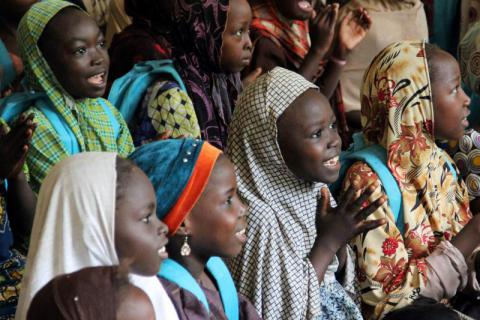 Internally displaced children attending classes at a displacement camp in Maiduguri, Borno state, Nigeria, September 2015 © 2015 Bede Sheppard/Human Rights Watch