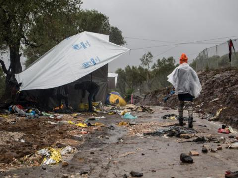 People desperately trying to find shelter at Moria camp, Greece