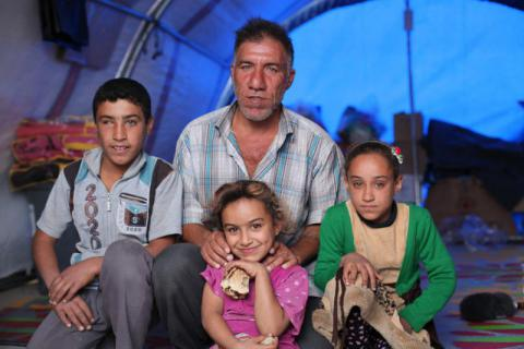 *Karim, 45 years fled his home town, just south of Mosul City when the fighting began.   He travelled with his five children and wife, (Pictured) *Altaf 11 - (grey top) (Pictured) *Aini 10 - Green and light cream (Girl) (Pictured) *Ghadir 7 - Pink top, *Futun 14 and *Anas13 . All of his children have not been to school for three years.