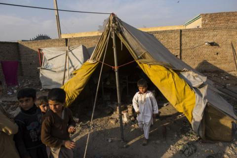 Arbaz (6, in white) with cousins outside his family's tent on the block of land where his and six other families are living in Jalalabad, Nangarhar, in eastern Afghanistan.  Andrew Quilty/Save the Children