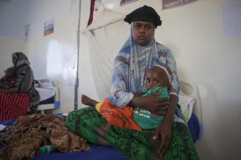 Fifteen-month-old Abdifatax* was brought to the hospital by his mother Laylo and his father Mohamed, suffering from malnutrition and related complications. Abdifatax* is being cared for in the Garowe General Hospital's stablisation unit in Puntland. Tom Pilston/Save the Children