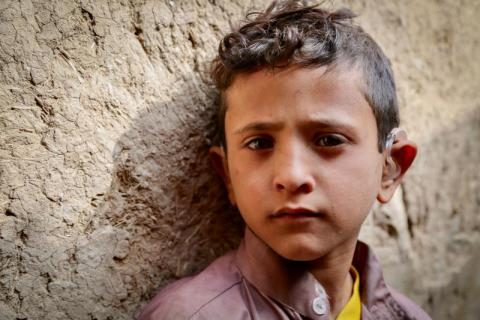 Ali*, 9, was seriously injured in an airstrike in June 2016, which left him deaf and unable to speak. Now he uses a hearing aid in both ears – and after surgery and time with a speech therapist, he is slowly beginning to talk again.