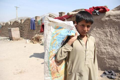 Jawid, 14, collects rubbish to sell to earn money for his family. Jawid returned to Afghanistan from Pakistan with his family in 2016 following a tightening of regulations by authorities in Pakistan. Evan Schuurman/Save the Children