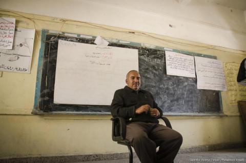 Abbas, the school Director at Saleem's school