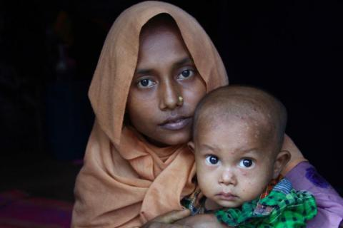 Majuma* fled her village in Northern Rakhine State with her husband and one and a half year old son after it was attacked by the military. It took them five days to reach Bangladesh on foot, where they have found shelter in one of the makeshift settlements. Evan Schuurman/Save the Children
