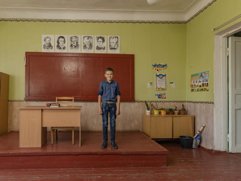 Vlad*, 11, in his classroom in Ukraine