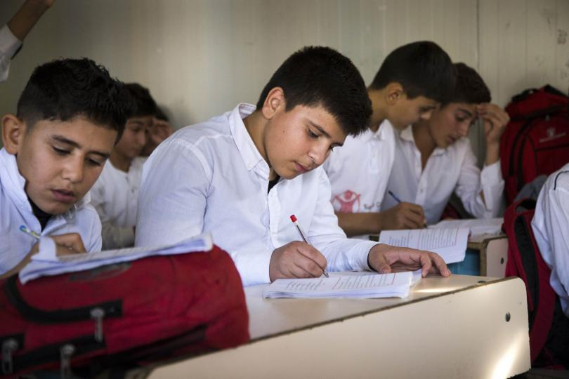Ranveer, 13, from Syria, at school in Iraq, before the COVID-19 pandemic
