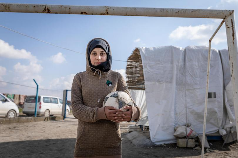 Sara*, 14, holds a football at Save the Children's Child Friendly Space, Syria.