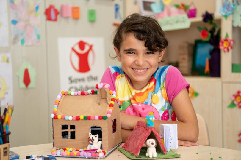 Najma*, 12, with her artwork at a Save the Children education centre in a camp for Syrian refugees in Iraq