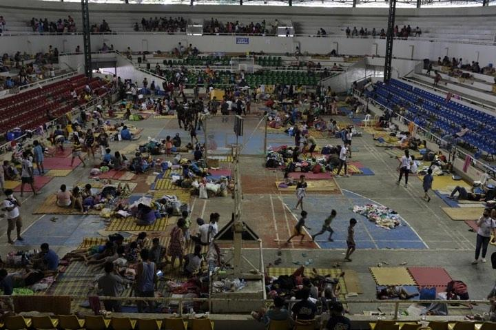 Families sheltering in Bauan Cockpit Arena which now serves as an evacuation centre