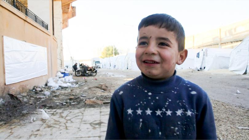 Faris*, 4, fled Ma'arat Nu'man with his family and is now sheltering in a former playground in Idlib, NW Syria
