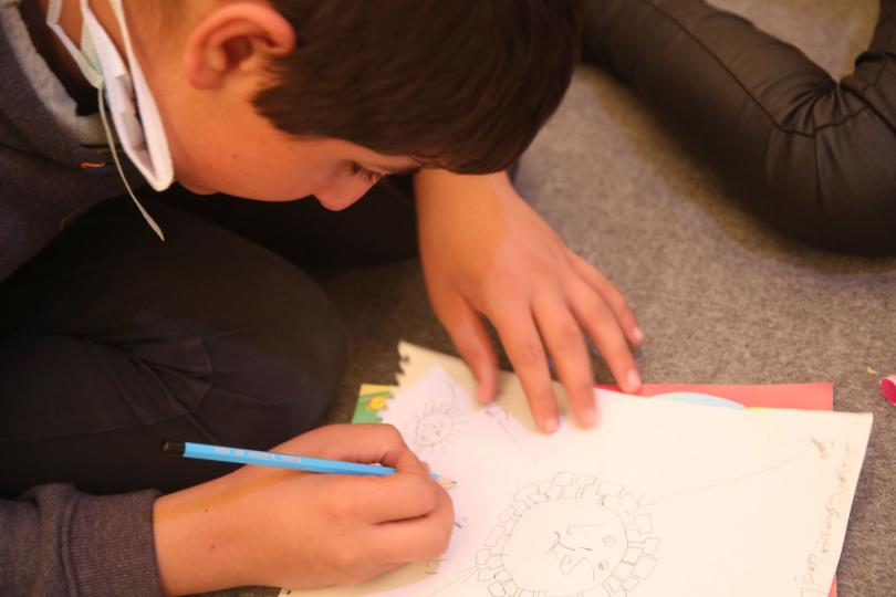 Rami*, 13, draws the coronavirus at home in a camp in North West Syria