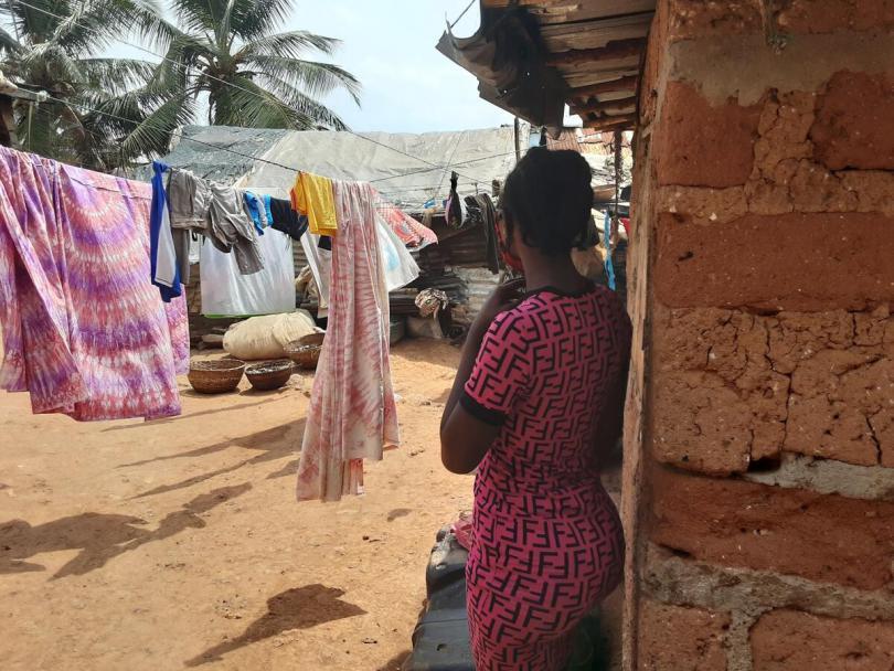 Kadiatu*, 18, pictured outside her home in a slum community in Freetown, Sierra Leone.