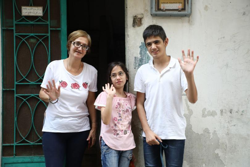 Marie-Helene with daughter Lama*, 11, and son Jad*, 14, outside their home, Beirut, Lebanon