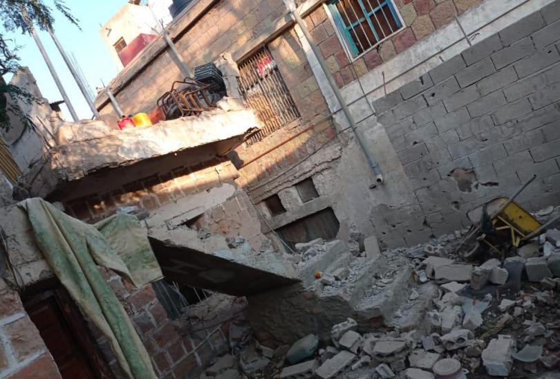 The damage caused by shelling to Hamdi*s family home