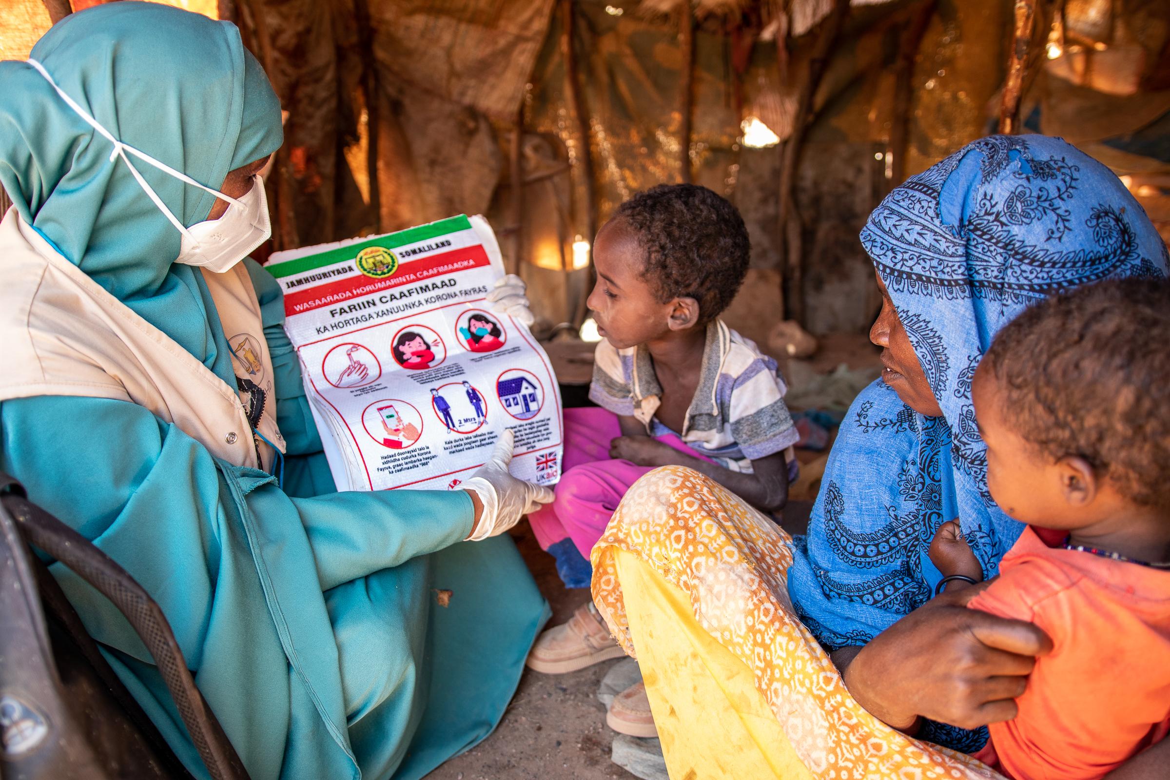 Muna showing guidance to some children