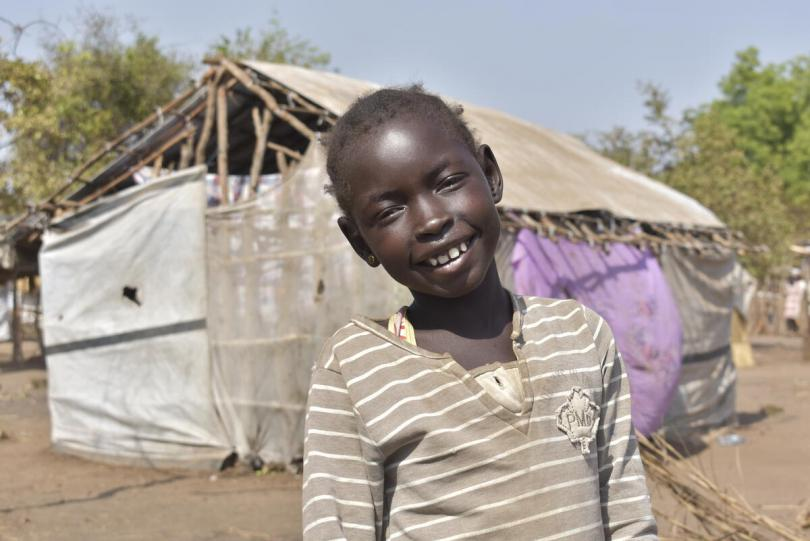 Adhiew* (8) at her temporary home after fleeing floods