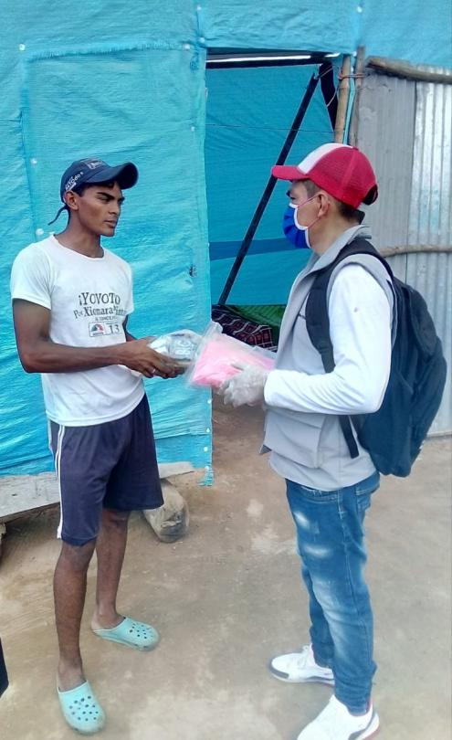 Wilfredo hands out education kits so that children can continue to learn throughout the coronavirus pandemic.
