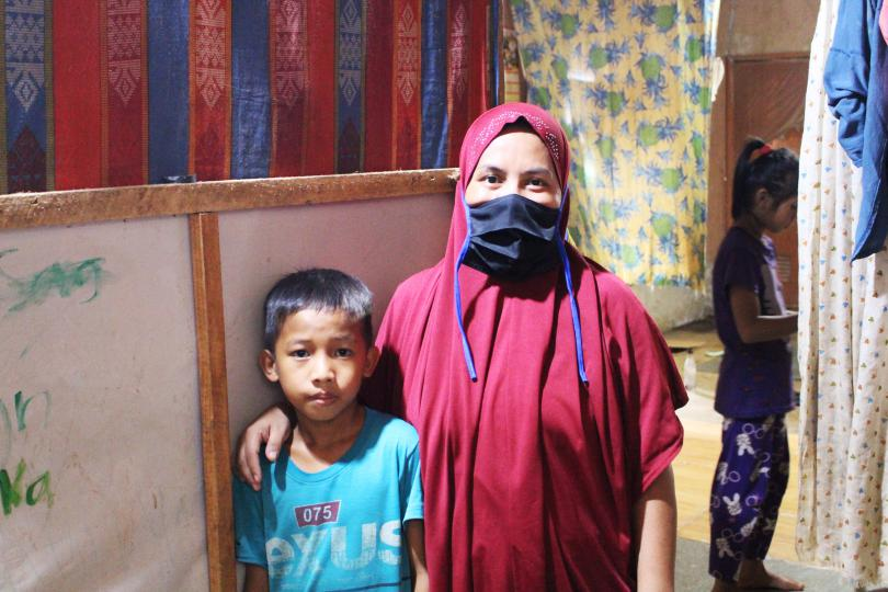 Abdul*, 10, with his mother, Philippines