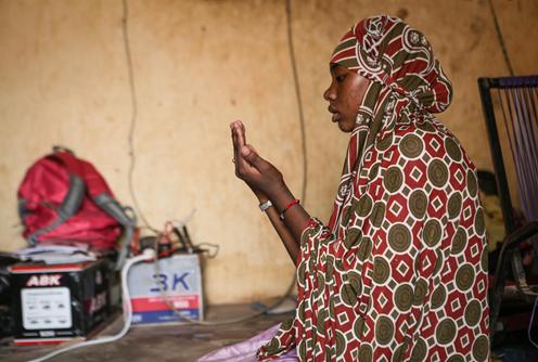 Kadidia*, aged 14, prays after school at her home in Mopti region, Mali.
