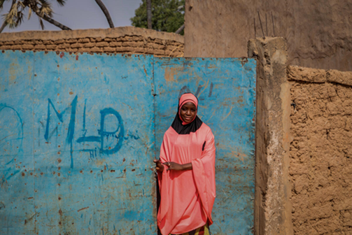 Dioura*, aged 12, outside her home in Tillaberi region, Niger.