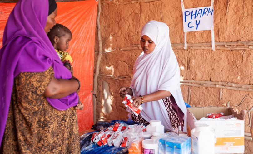A medical staff member speaks to a mother and child in Somalia