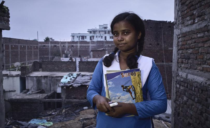 Munni, 16, at home after teaching a literacy class in Bihar, India