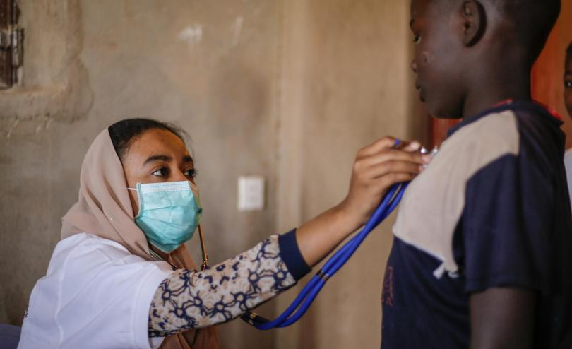 A doctor treats a child during the coronavirus pandemic