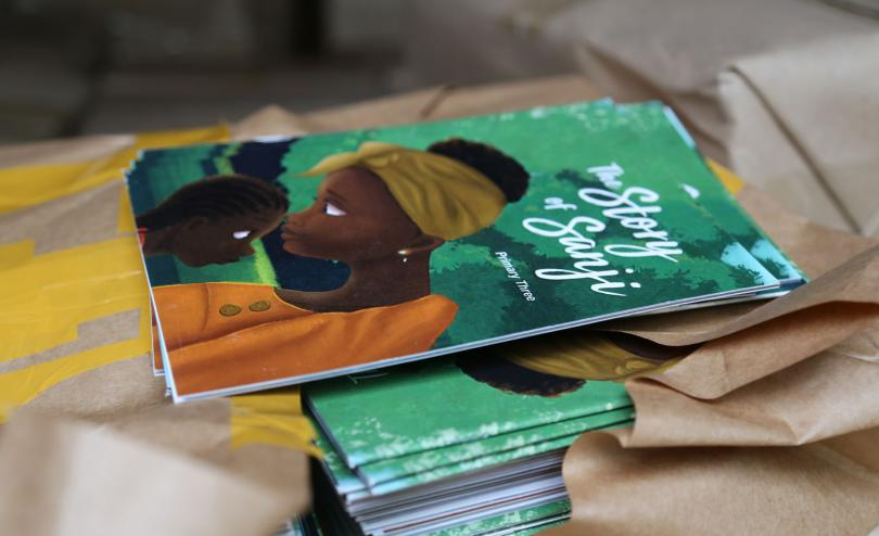 A book is distributed in Uganda