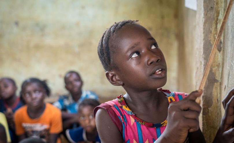 A girl reads in Sierra Leone