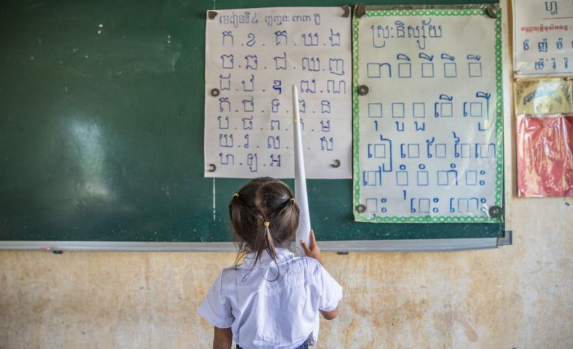 A girl stands at the blackboard in Cambodia