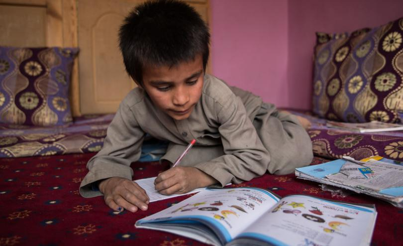 Hemat*, 10, does his homework