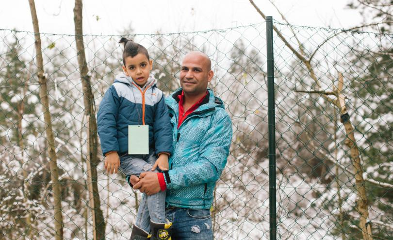 Bosnia Refugees Winter, Omar* aged 6 and his father housed in a camp supported by STC