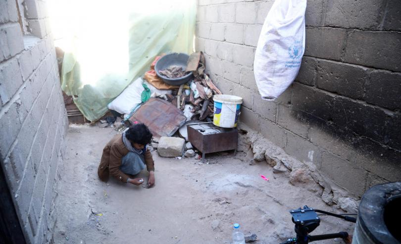 Abed*, 11, plays with marbles outside his home