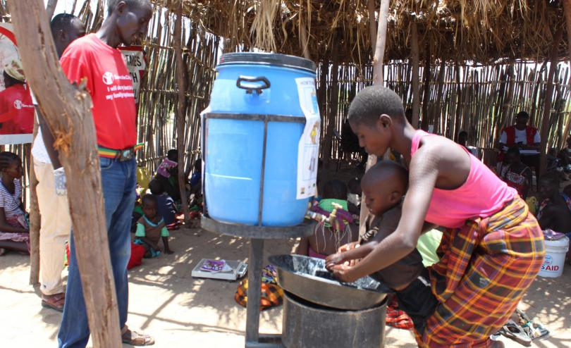 Rebecca, from Central Turkana, washing hands of her child to curb the spread of Covid-19