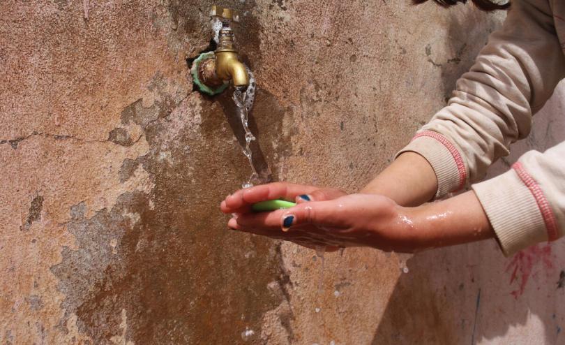 Tala*, 9 washing her hands