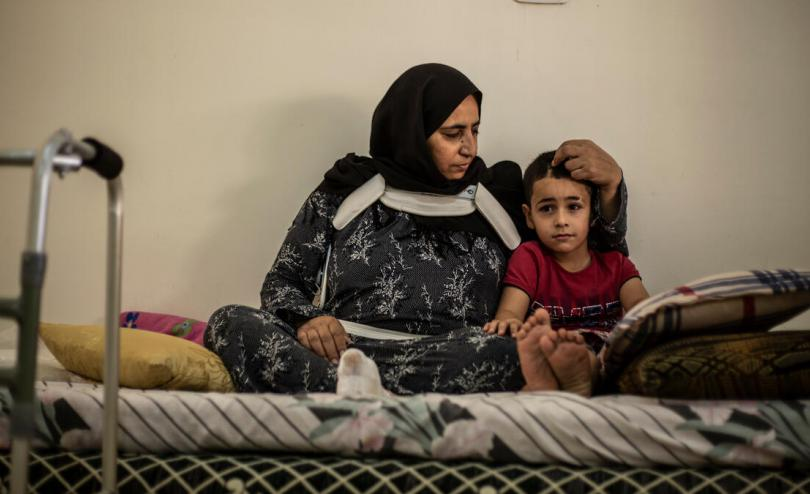 Said*, 6, is comforted by his mother Em Mahmoud at their home in Beirut