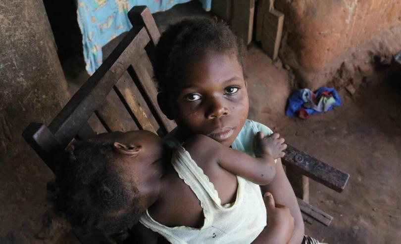 Michelle*, nine years old and her one year old sister, Gloria* in Kasai region, DRC