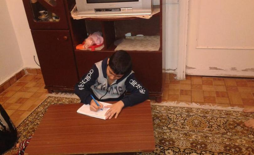 Adam*, 11, says he's struggling with remote learning due to the lack of access to a good Internet connection. Beirut, Lebanon