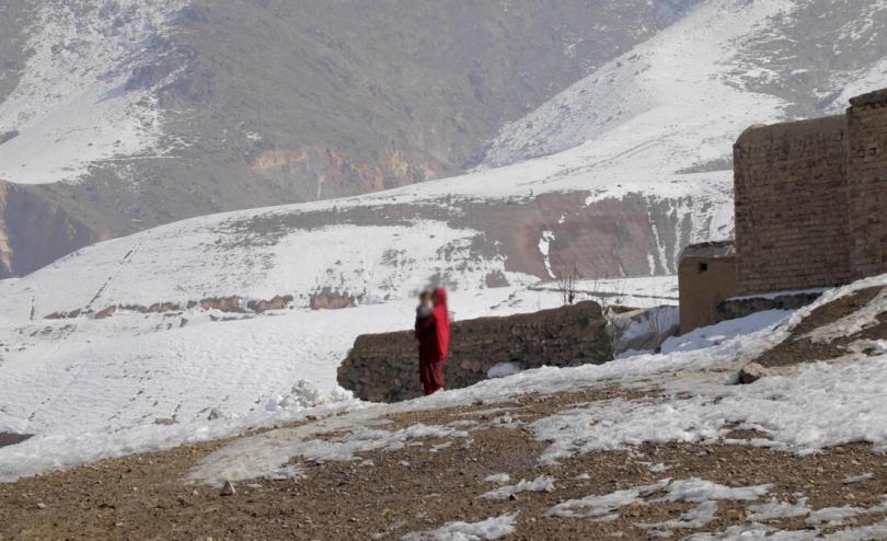 Afghan child carries sibling