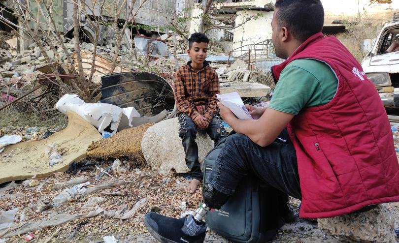 Mubarak*, Save the Children Volunteer in Taiz, Yemen with Bara'a* 11, one of the children he's assisting