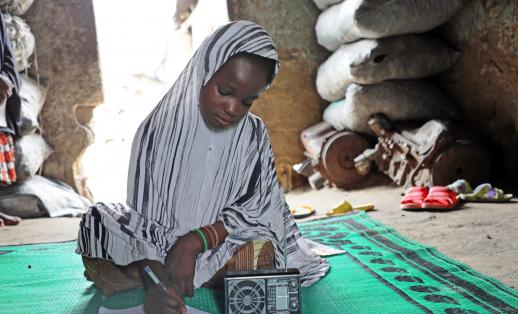 Asmau*, 12, studies at home thanks to radio learning supported by Save the Children in Nigeria