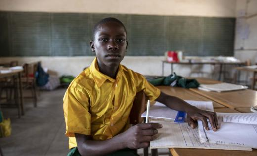 A boy sits in his classroom in Zimbabwe after a session on DRR