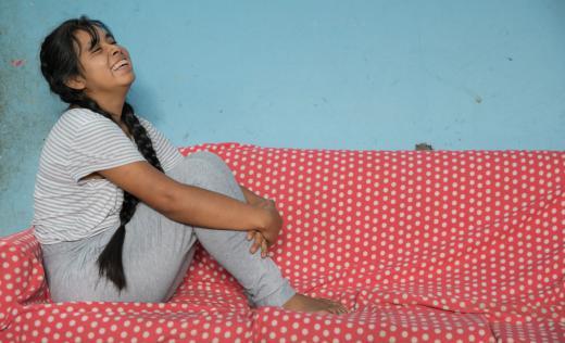 Estefany*, 15, sits in her home in Huanuco, Peru