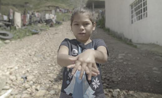 A girl shows how to wash your hands in Mexico