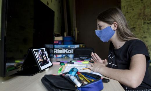 Out of school children are using tablets for home learning during the coronavirus pandemic in Italy
