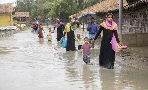 Families wade through flood water