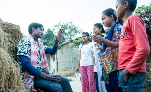 Children in Nepal discuss their rights with an adult